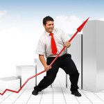 Business man helping a red graph arrow